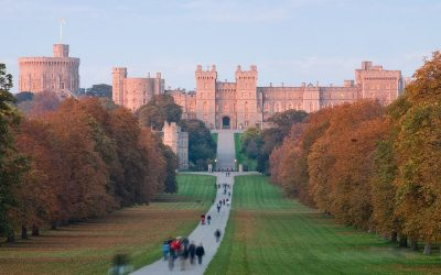 Windsor Castle at sunset as viewed from the Long Walk in Windsor, England. Photo Credit: © David Iliff via Wikimedia Commons.