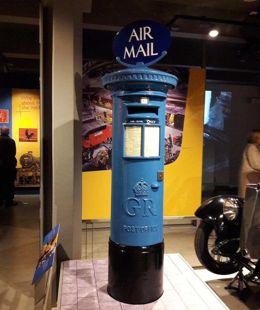 Blue Air Mail box at Postal Museum in London. Photo Credit: © Gaius Cornelius via Wikimedia Commons.