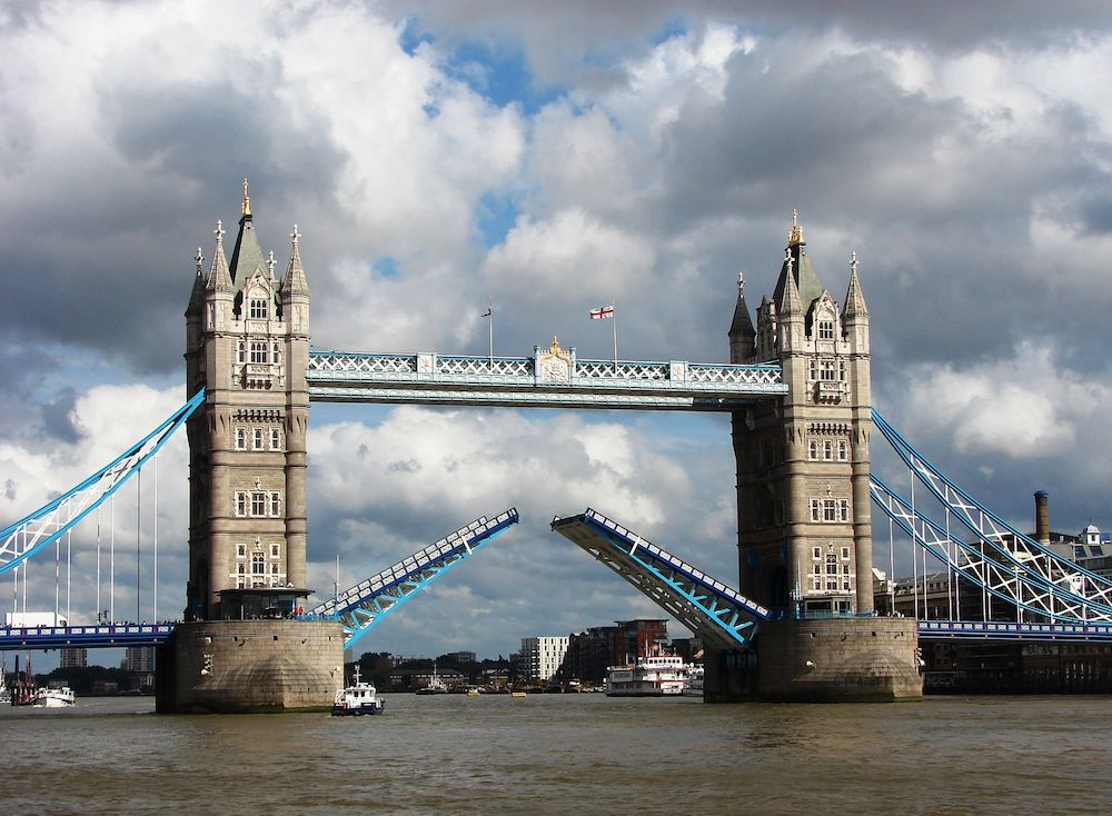 Tower Bridge in London being opened. Photo Credit: © Mvkulkarni23 via Wikimedia Commons.