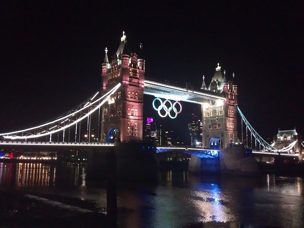 Tower Bridge in London with Olympic Rings during the 2012 London Olympics. Photo Credit: © Look4myblog via Wikimedia Commons.