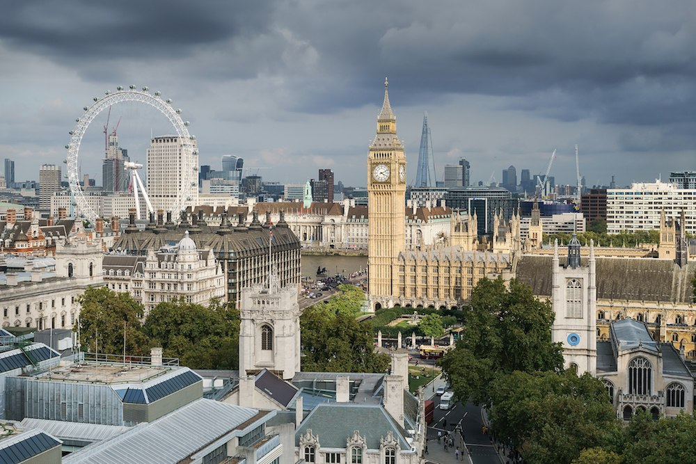 London skyline with Big Ben and environs, including the London Eye, Portcullis House, Parliament Square, and St Margaret's Church. Photo Credit: © Colin via Wikimedia Commons .